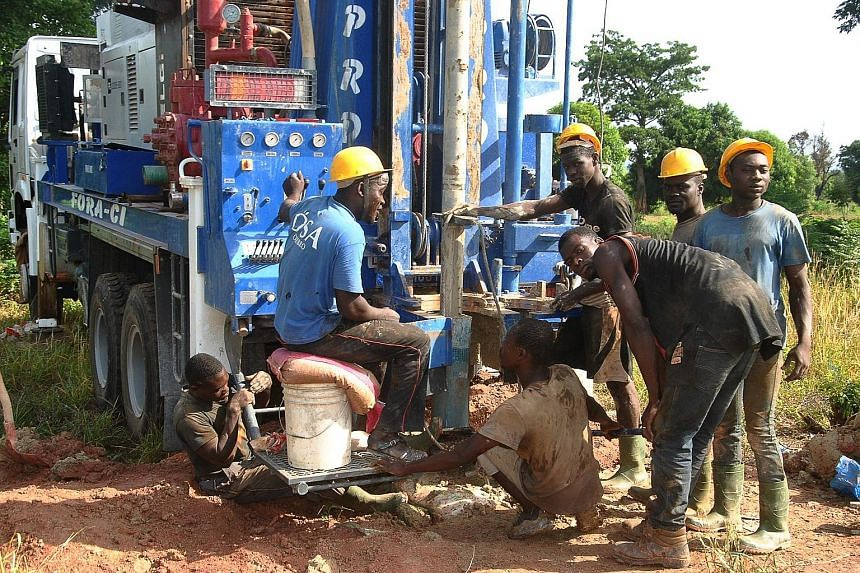 Workers drilling a well last Friday near Bouake, which has been suffering from a water shortage for three weeks as the dammed lake that supplies 70 per cent of the city's water has run dry.