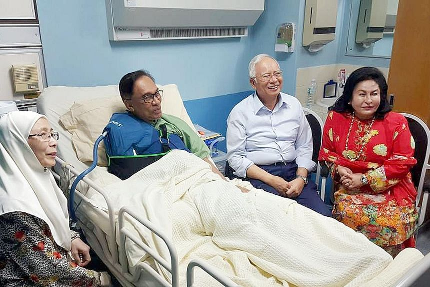 Malaysian Prime Minister Najib Razak and his wife, Datin Seri Rosmah Mansor, visiting jailed opposition leader Anwar Ibrahim in Hospital Kuala Lumpur on Nov 17, after the latter had an operation to his shoulder. With them was Anwar's wife, Datuk Seri