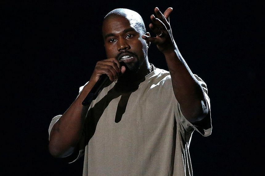 "Rapper Kanye West (right) showed his admiration for United States President Donald Trump (left) on Wednesday in a string of tweets, saying that they both have ""dragon energy""."