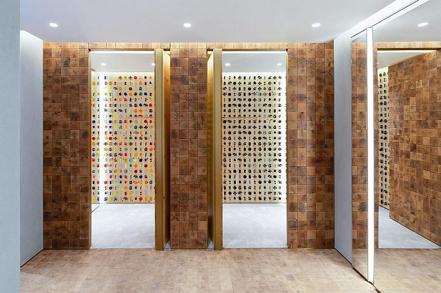 The fitting rooms (right) in Stella McCartney's new Paragon store are finished with reclaimed end grain wood blocks manufactured from red and white oak grown in the Tennessee and Kentucky region. For the past 17 years, designer Stella McCartney (left