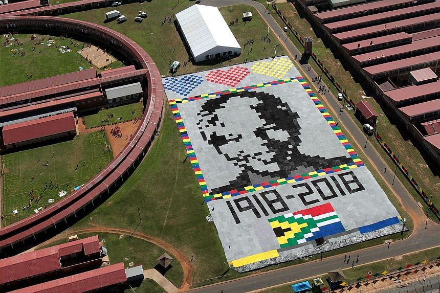 A massive Mandela masterpiece made up of crochet blankets was unveiled at Zonderwater Prison outside Cullinan, South Africa, on Tuesday. It is in celebration and memory of Mr Nelson Mandela's centenary year. The blankets will be handed out to the nee