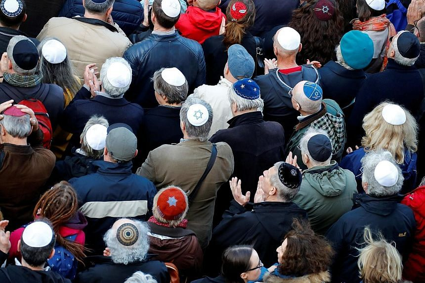 Demonstrators wearing kippas protesting in front of a Jewish synagogue in Berlin on Wednesday to denounce an anti-Semitic attack on a kippa-wearing young man in the capital earlier this month. A spate of shocking anti-Semitic incidents has raised poi