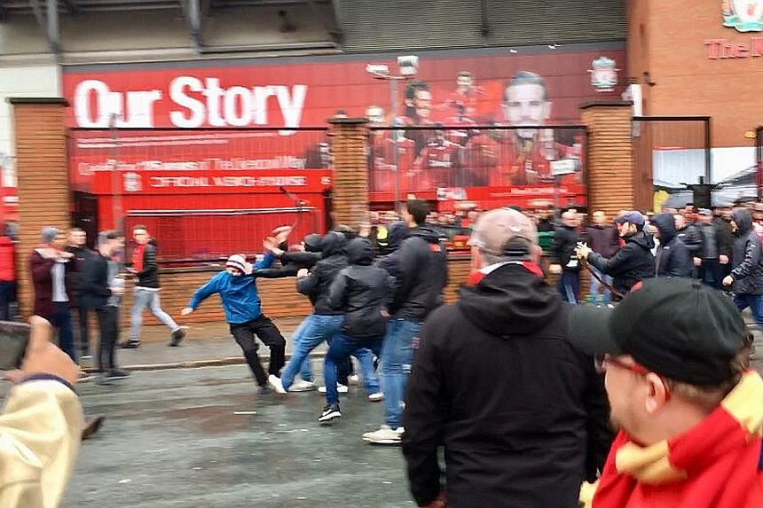 BBC sports correspondent David Ornstein posted this image of an attack before the Liverpool-Roma game on Tuesday. The Reds' Alex Oxlade-Chamberlain made mention of the fan who is fighting for his life.