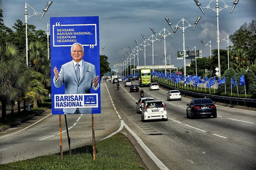 A Barisan Nasional campaign poster of Prime Minister Najib Razak in Putrajaya. For the first time, the Umno-led BN must face an opposition led by a former premier.