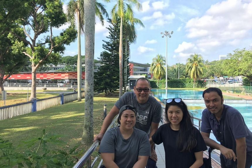 The palm trees around Farrer Park Swimming Complex have been around since it opened in 1957. Here, local swim icon Ang Peng Siong, once the world's fastest swimmer in 1982, poses with Paralympic swim stars Theresa Goh (front left), Yip Pin Xiu (centr