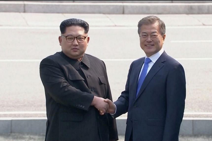 North Korean leader Kim Jong Un shakes hands with South Korean President Moon Jae In as both of them arrive for the inter-Korean summit at the truce village of Panmunjom, on April 27, 2018.