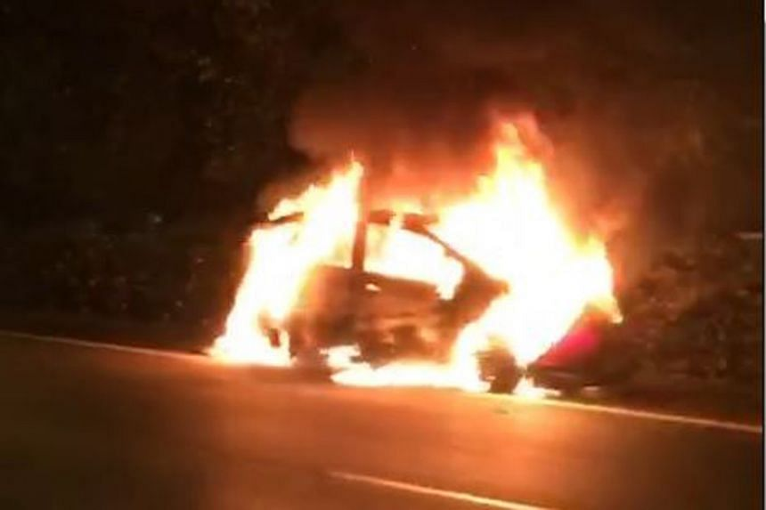 The blaze engulfed the vehicle on the leftmost lane of the Ayer Rajah Expressway, towards Tuas, after the Buona Vista Exit, on April 27, 2018.