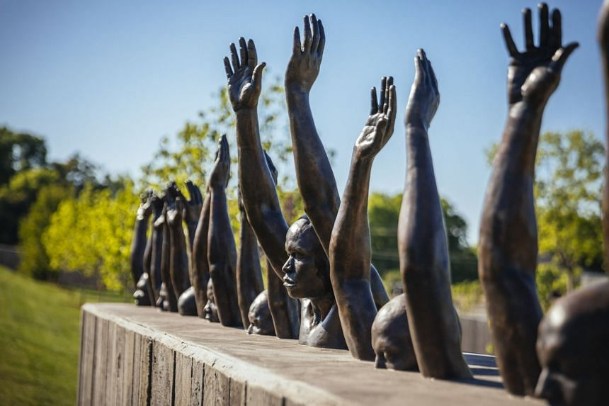 Raise Up, a sculpture by Hank Willis Thomas, on the grounds of the National Memorial for Peace and Justice in Montgomery, Alabama.