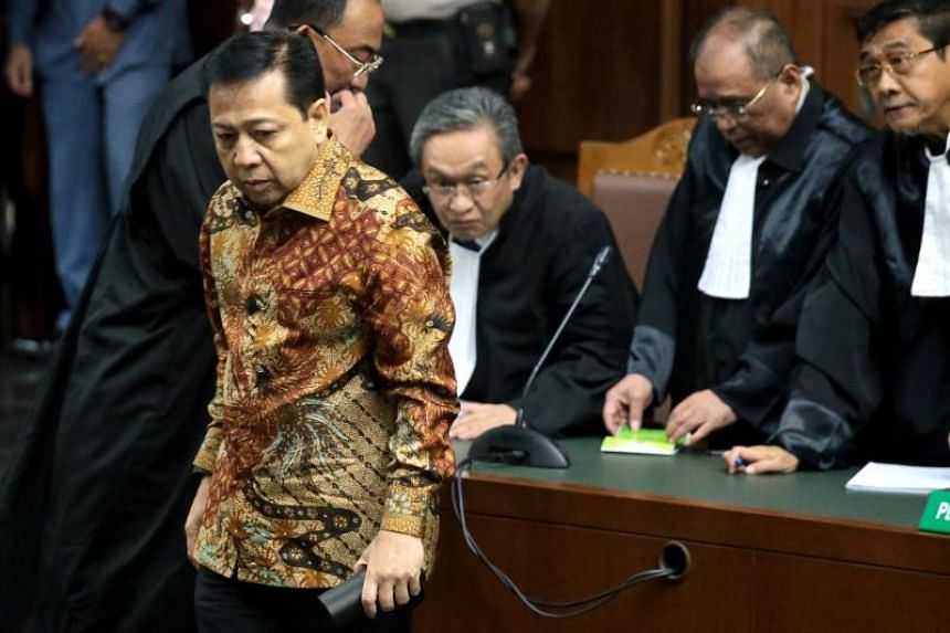 Indonesian Parliament Speaker Setya Novanto walks inside the court room during his trial at Central Jakarta's court in Jakarta, Indonesia, on April 24, 2018.