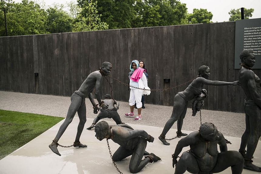 A sculpture commemorating the slave trade greets visitors at the entrance National Memorial For Peace And Justice.