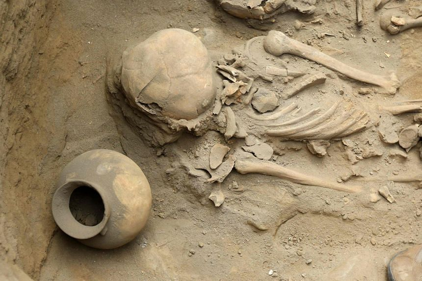 Human remains and pottery items dating more than 1,500 years were found at an excavation site in the northern coastal town of Huanchaco, Peru, on March 21, 2018.