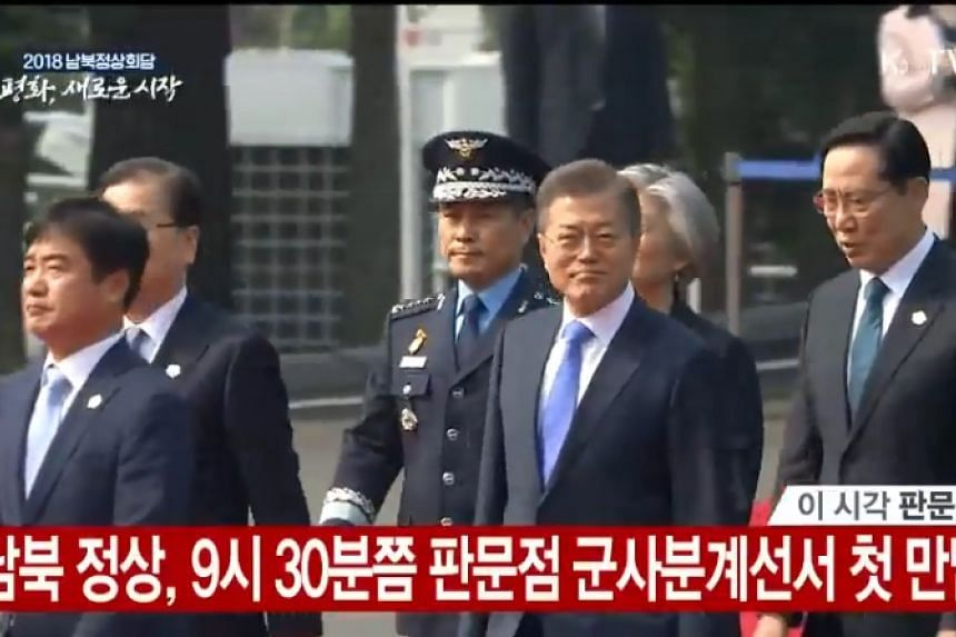 South Korean President Moon Jae In arrives at the truce village of Panmunjom on the southern side of the border.
