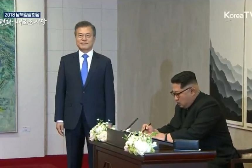 North Korean leader Kim Jong Un signing a guest book after the welcome ceremony.