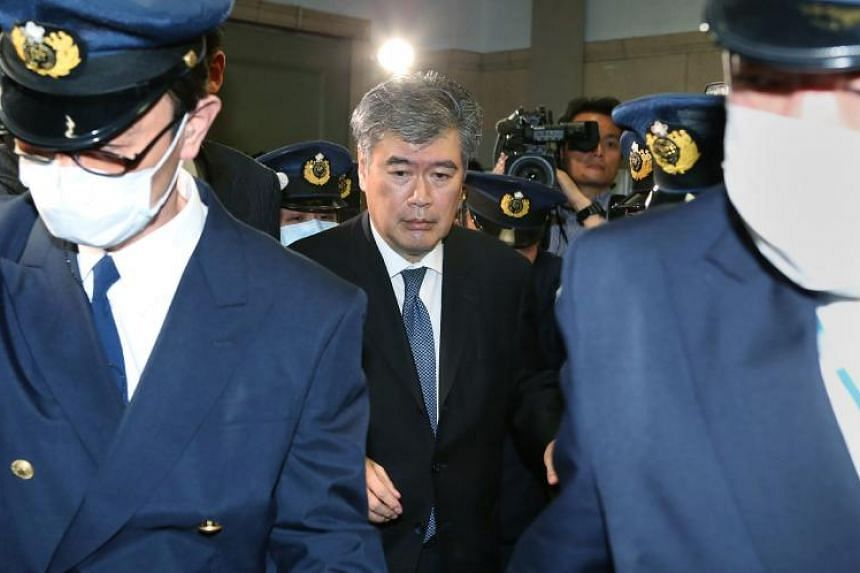 Japan's Administrative Vice Finance Minister Junichi Fukuda leaves the finance ministry in Tokyo on April 16, 2018.