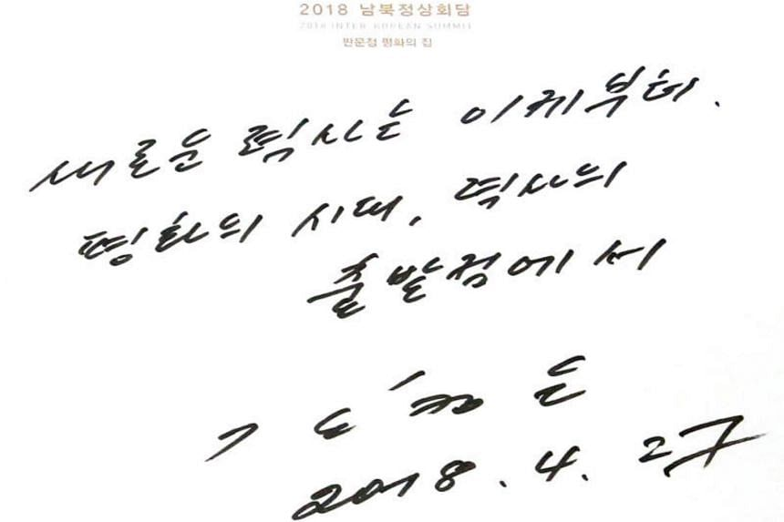 A message written in a guest book by North Korea's leader Kim Jong Un during the Inter-Korean summit at the Peace House building in the truce village of Panmunjom on April 27, 2018.