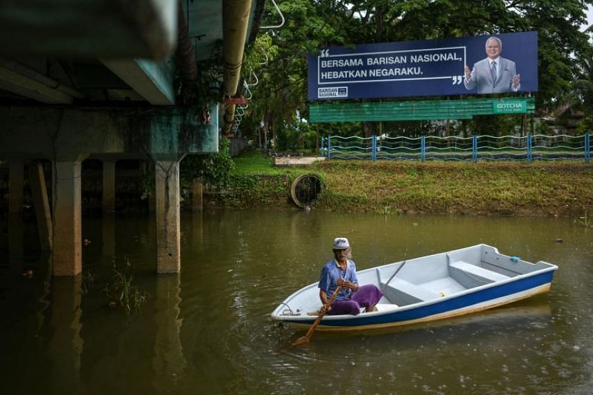 An advertisement for Malaysia's Prime Minister Najib Razak of the Barisan National Party is seen in Pekan, Pahang, ahead of the 14th general election on April 27, 2018.