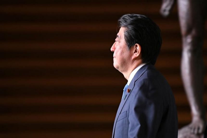 Japan's Prime Minister Shinzo Abe leaves his official residence in Tokyo on April 27, 2018.