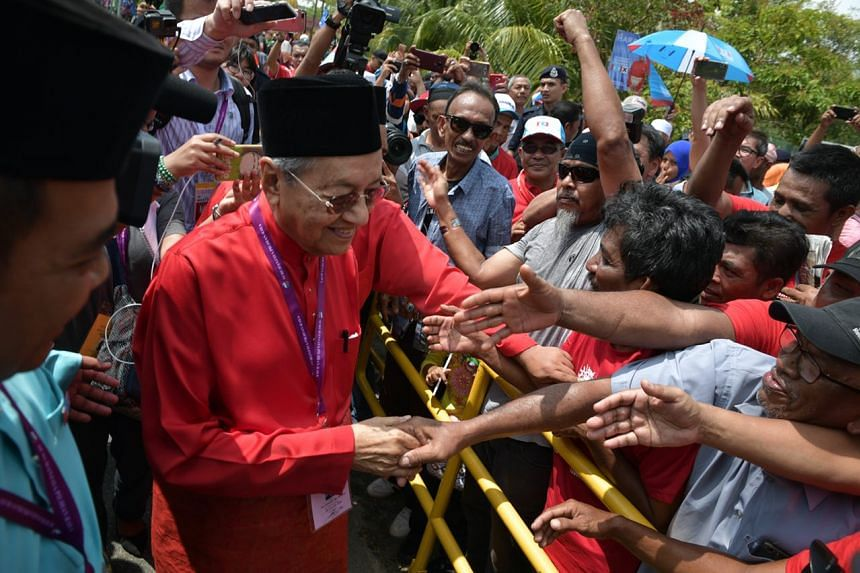 Dr Mahathir Mohamad greets supporters in Langkawi's main town, Kuah, on April 28, 2018.