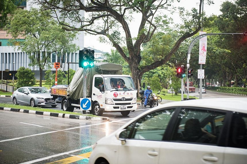 Above: At this Tampines traffic junction, the number of accidents has fallen sharply since the measure was introduced. Left: The same was true for this junction connecting Thomson Road and Moulmein Road.
