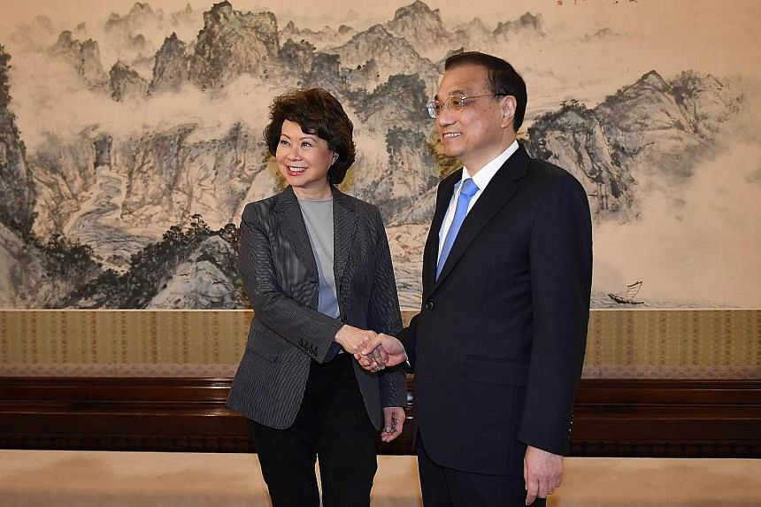 Chinese Premier Li Keqiang with US Secretary of Transportation Elaine Chao in Beijing on Thursday.