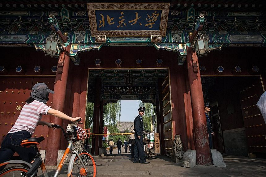A security guard at the entrance to Peking University in Beijing. A student has penned an open letter accusing the university of trying to silence her #MeToo activism.