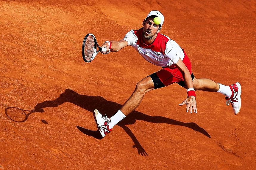 Serbia's Novak Djokovic on the way to a 2-6, 6-1, 3-6 defeat by Slovakia's 140th-ranked Martin Klizan in second round of the Barcelona Open on Wednesday.