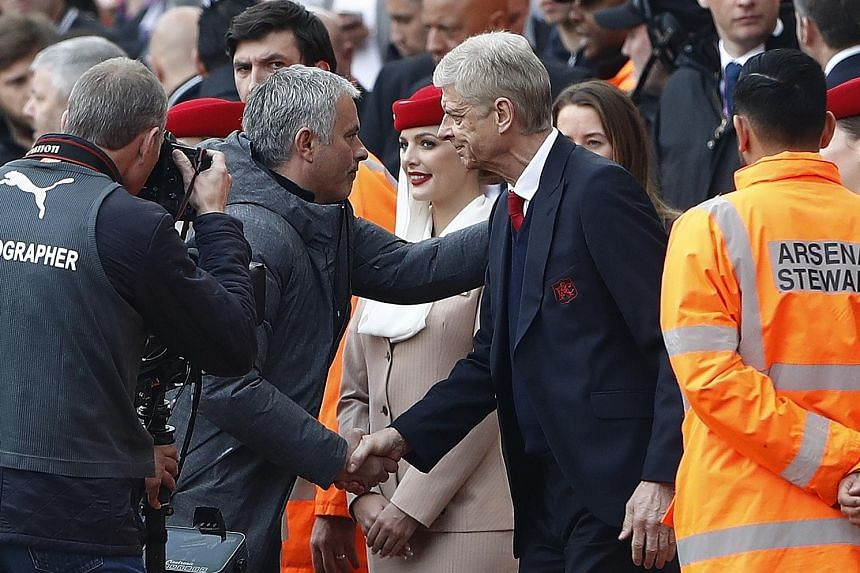 Jose Mourinho and Arsene Wenger shaking hands before their teams clashed at the Emirates in May last year. Mourinho has urged the Old Trafford crowd to give the Frenchman a courteous reception for his final game at the stadium.