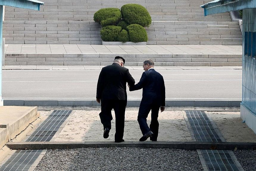 North Korean leader Kim Jong Un and South Korean President Moon Jae In shook hands for 22 seconds at the truce village of Panmunjom yesterday before Mr Kim invited Mr Moon to cross the Military Demarcation Line into the North Korean side. Mr Moon acc
