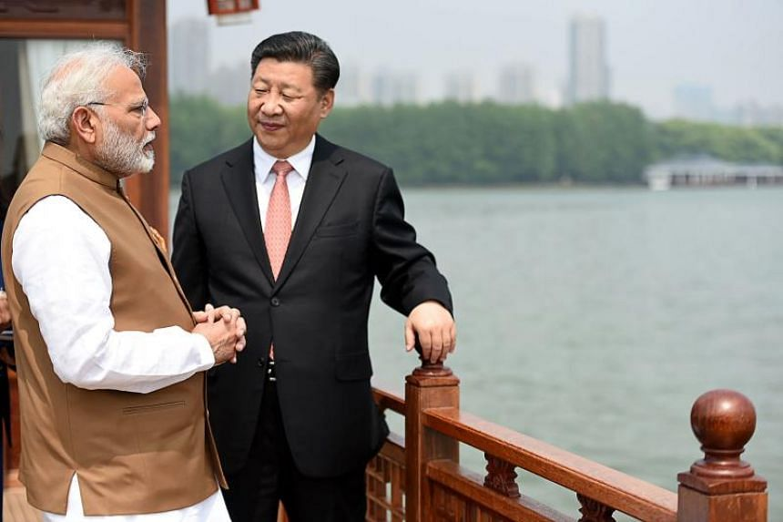 India's Prime Minister Narendra Modi (left) and Chinese President Xi Jinping looking on in a house boat, at East Lake, in Wuhan, on April 28, 2018.