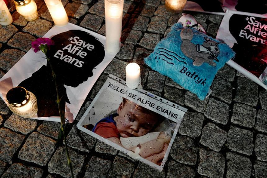 Candles and placards placed during a protest in support of Alfie Evans, in front of the British Embassy building in Warsaw, Poland, on April 26, 2018.