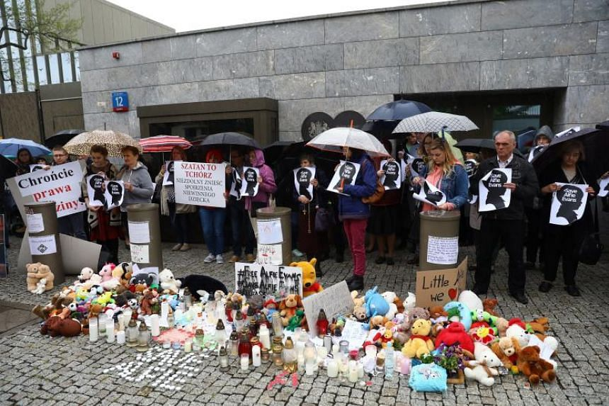 People take part in the rally for the life of Alfie Evans in front of the embassy of Great Britain in Warsaw, Poland, on April 26, 2018.