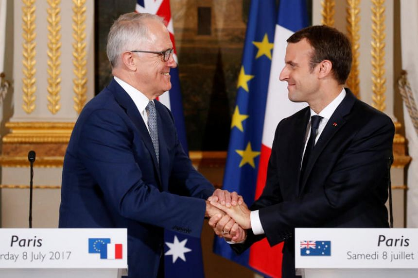 French President Emmanuel Macron shakes hands with Australian Prime Minister Malcolm Turnbull at the Elysee Palace in Paris, France, on July 8, 2017.
