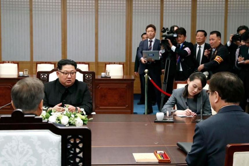 South Korea's President Moon Jae In attends the Inter-Korean summit with North Korea's leader Kim Jong Un and his sister Kim Yo Jong in the Peace House building on the southern side of the truce village of Panmunjom on April 27, 2018.