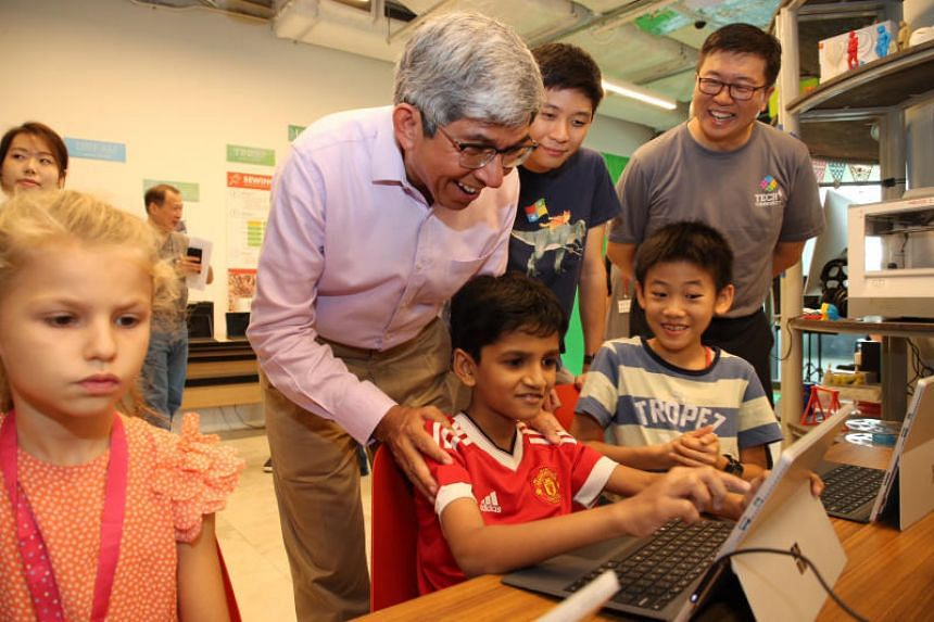Dr Yaacob Ibrahim, Minister for Communications and Information, stopped by the Coding for Youth class at the Tech4Community Festival, on April 28, 2018.