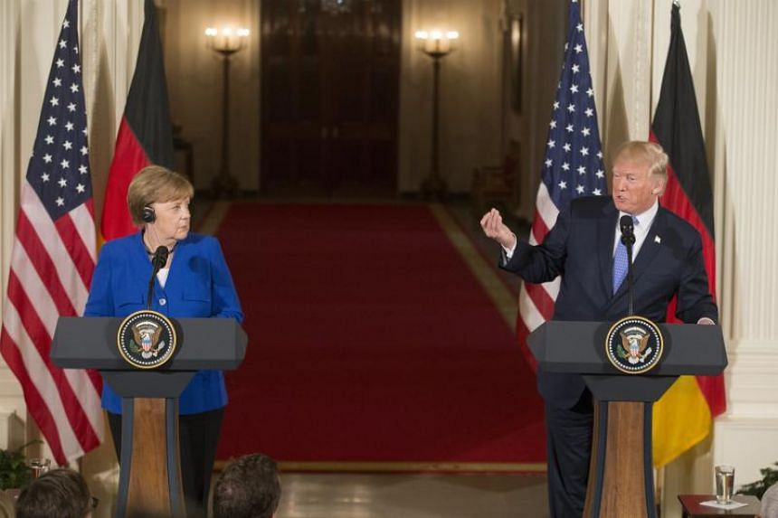 US President Donald Trump (right) and Chancellor of Germany Angela Merkel hold a joint news conference in the East Room of the White House in Washington, on April 27, 2018.