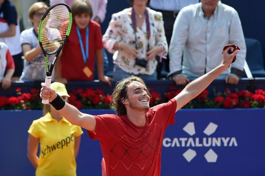 Greece's Stefanos Tsitsipas celebrates after beating Spain's Pablo Carreno Busta during their Barcelona Open ATP tournament semi-final tennis match in Barcelona on April 28, 2018.
