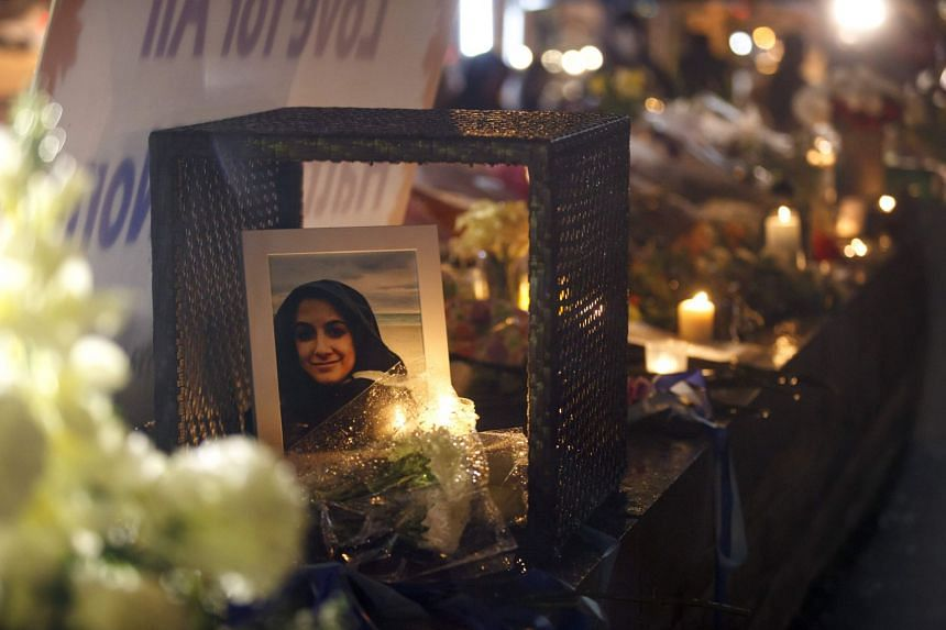 A photograph of Anne Marie D'Amico,one of the victims, is seen at a memorial in Toronto.