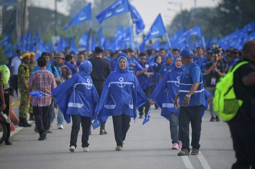Barisan Nasional supporters marching towards the nomination centre in Bagan Datoh.