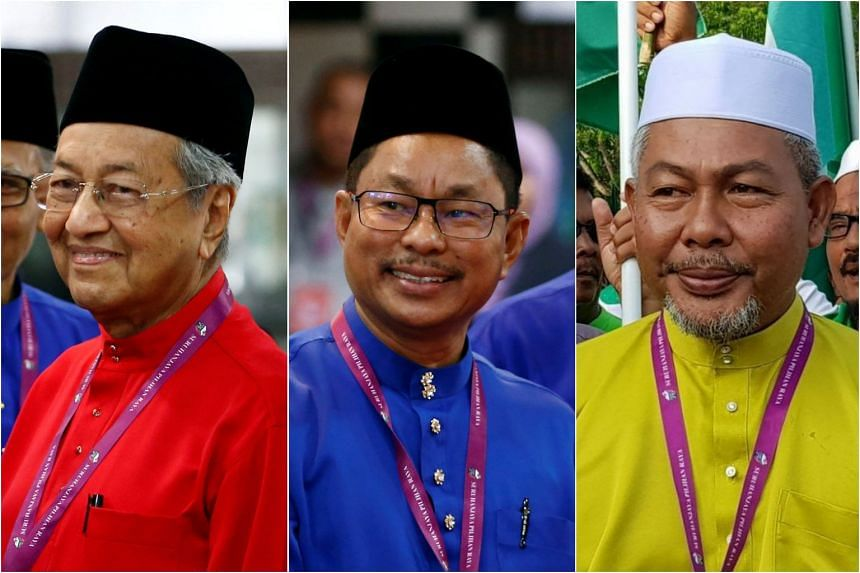 Dr Mahathir (left) is facing a three-cornered fight against BN's incumbent MP Nawawi Ahmad (centre) and Langkawi PAS chief Zubir Ahmad.