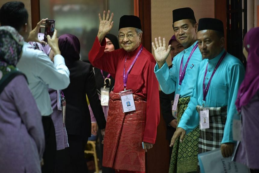 Pakatan Harapan chairman and opposition leader Mahathir Mohamad (centre, in red) at the Langkawi District and Land Office in Kuah, on April 28, 2018.