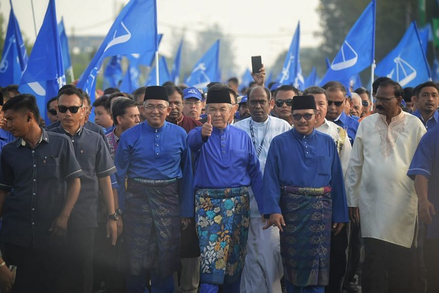 Deputy Prime Minister Ahmad Zahid Hamidi and supporters marching towards the nomination centre in Bagan Datoh.