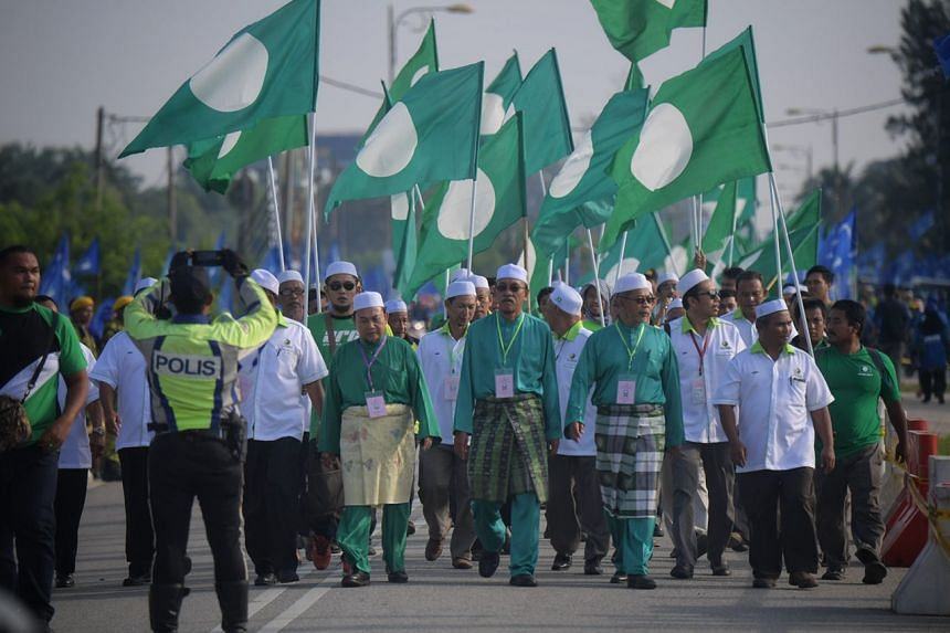 PAS candidates and supporters marching into the nomination centre in Bagan Datoh.