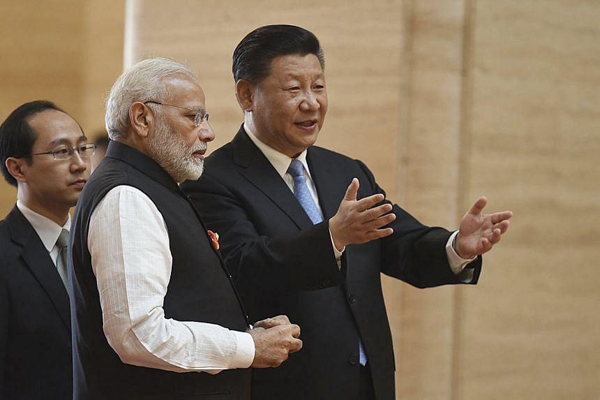 Chinese President Xi Jinping and Indian Prime Minister Narendra Modi at a welcoming ceremony in Wuhan yesterday.