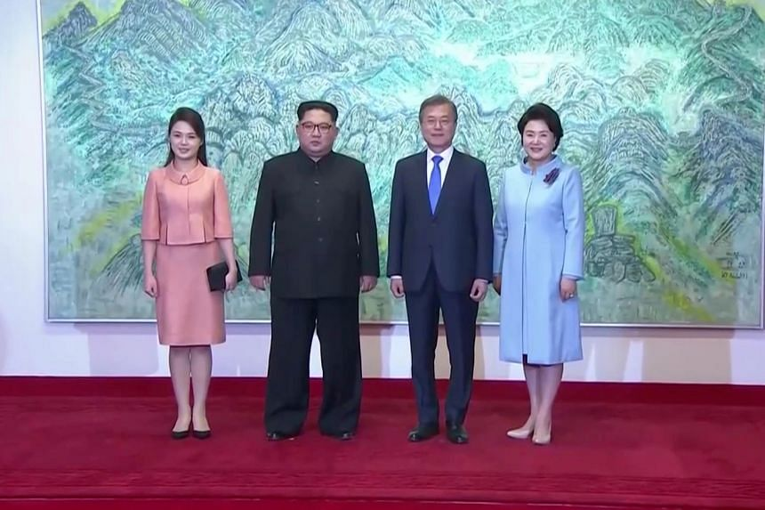 North Korean leader Kim Jong Un and his wife Ri Sol Ju with South Korean President Moon Jae In and his wife Kim Jung Sook at the summit yesterday. Ms Ri and Ms Kim were both professional singers before their marriages.