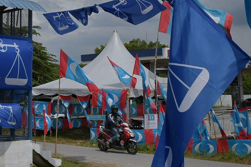 Party flags in the town of Permatang Pauh, mainland Penang, yesterday. Candidates who want to contest in Malaysia's 14th general election will register themselves today.