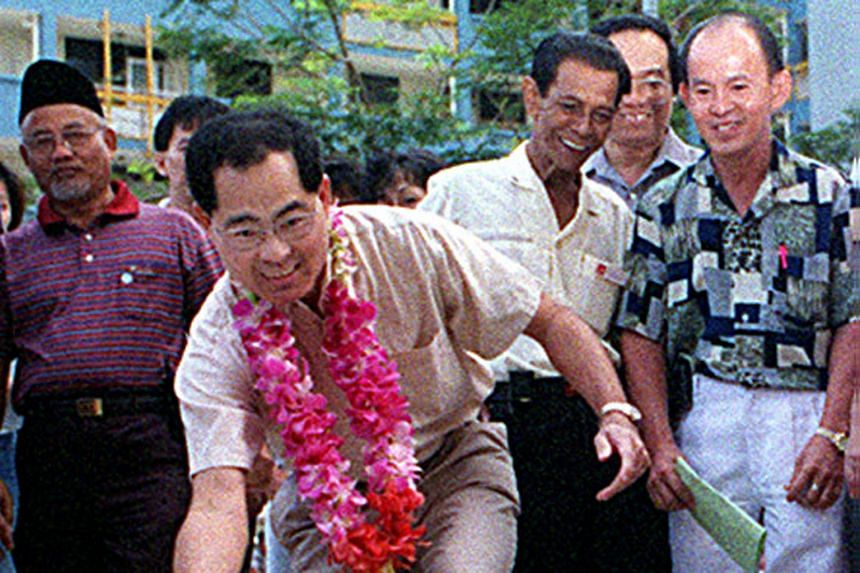 With Kampong Ubi residents in 1999.