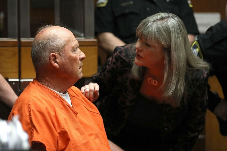 DeAngelo talks with public defender Diane Howard as he appears in court for his arraignment.