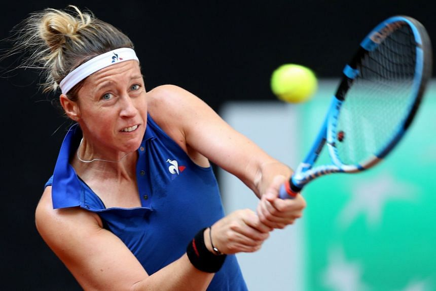 Parmentier in action during her semi-final match against Irina-Camelia Begu of Romania.