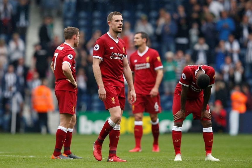 Liverpool's Jordan Henderson and team mates look dejected after the match.