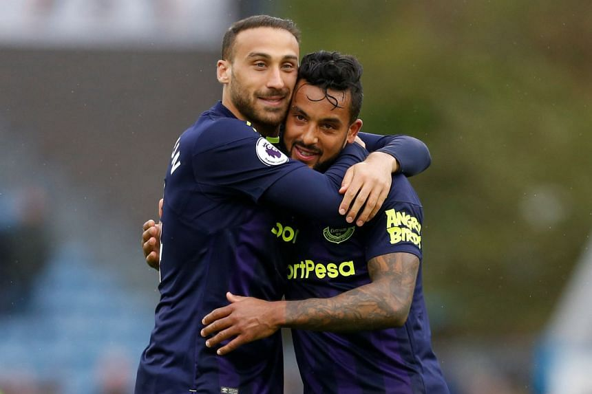 Everton's Theo Walcott and Cenk Tosun celebrate after the match.